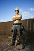 Male Construction Worker Stands with Folded Arms — Φωτογραφία Αρχείου