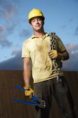Construction Worker with Bolt Cutters and Chain — Stok fotoğraf
