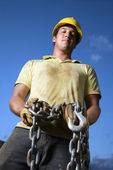 Construction Worker Holding Chain — Photo
