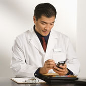 Doctor in office. — Stock Photo