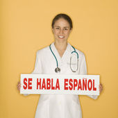Doctor and Spanish sign. — Stock Photo
