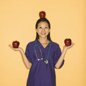 Doctor and apples. — Stock Photo