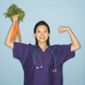 Doctor and carrots. — Stock Photo