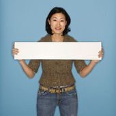 Woman holding blank sign. — Stock Photo