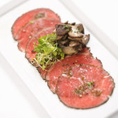 Beef carpaccio with mushrooms. — Stock Photo