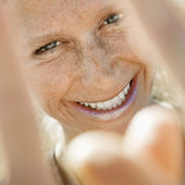 Smiling woman gesturing. — Stock Photo