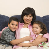 Family hugging together. — Stock Photo