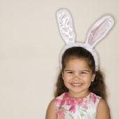 Girl wearing bunny ears. — Stock Photo