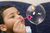Boy blowing bubble. — Stock Photo