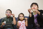 Family blowing bubbles. — Stock Photo