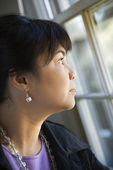 Woman gazing out window. — Stock Photo