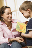 Boy giving mom drawing. — Stock Photo