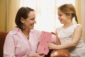 Girl giving mom drawing. — Stock Photo