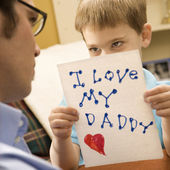 Boy giving dad drawing. — Stock Photo