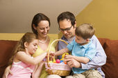 Family with Easter basket. — Stock Photo