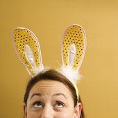 Woman wearing rabbit ears. — Stock Photo