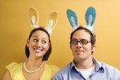 Couple wearing rabbit ears. — Stock Photo