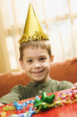 Boy holding birthday gift. — Stock Photo