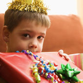 Boy holding gift. — Stock Photo
