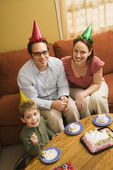 Family eating birthday cake. — Stock Photo
