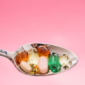 Spoonful of Pills. Isolated — Stock Photo