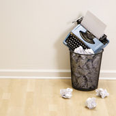 Typewriter in trash can. — Stock Photo