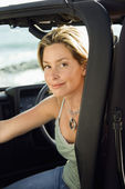 Smiling Woman Sitting in Car — Stock Photo