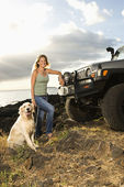Woman and Dog by SUV at the Beach — Stock Photo
