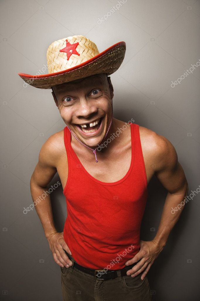 Portrait of a Mid-adult Caucasian male wearing straw hat with funny expression. — Stock Photo #9552152