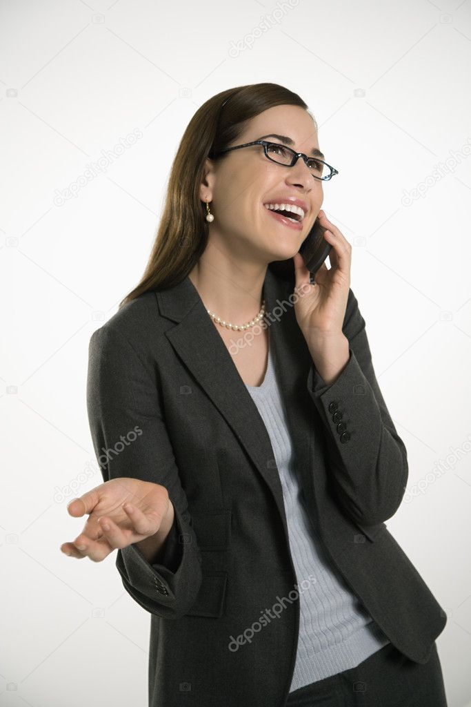 Caucasian mid adult professional business woman talking on cell phone with hand out and smiling. — Stock Photo #9552521
