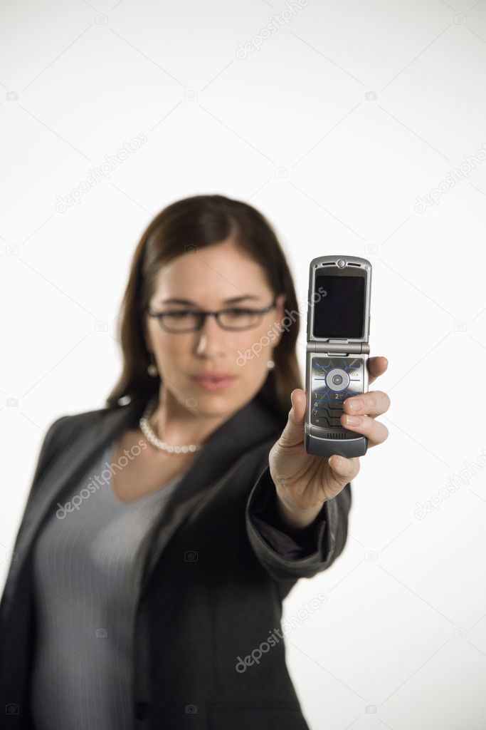 Caucasian mid adult professional business woman taking picture of self with camera phone. — Stock Photo #9552532