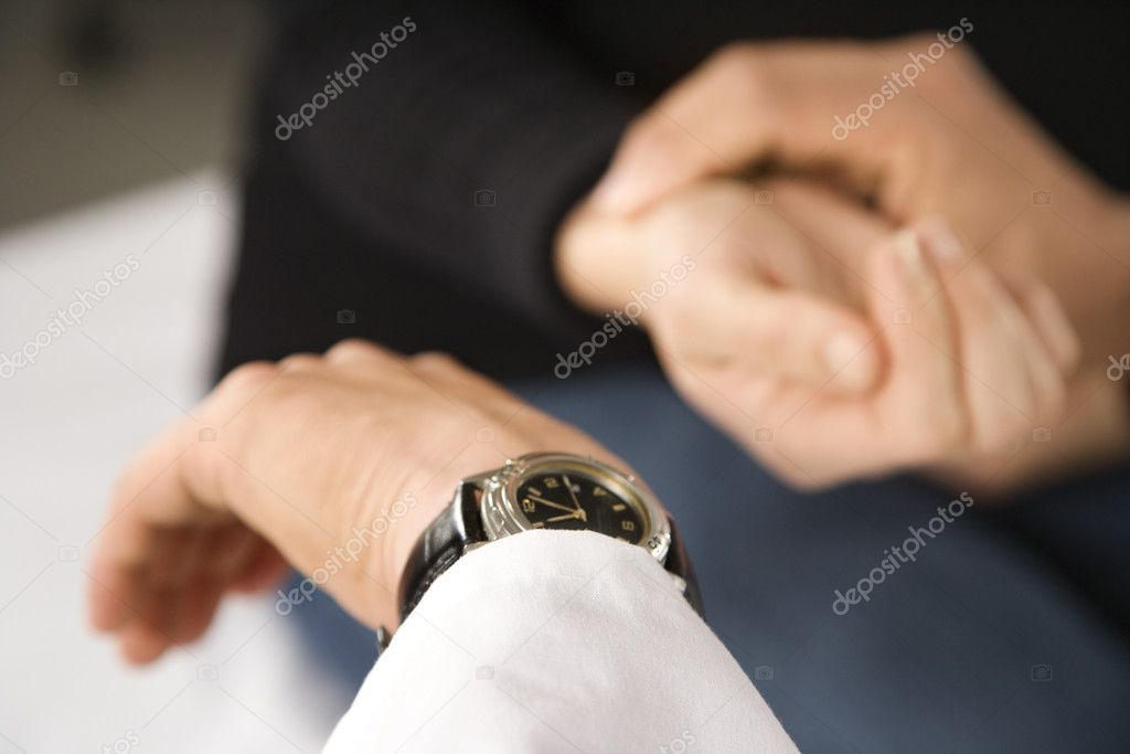 Doctor taking patient's pulse. — Stock Photo #9552649