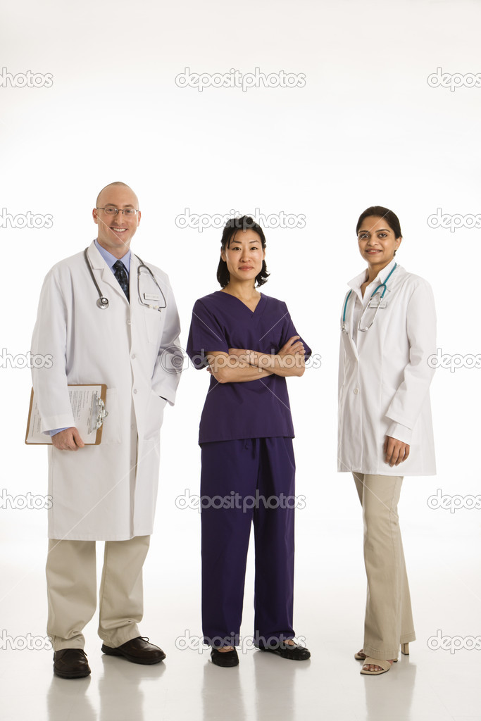 Caucasian mid adult male physician with Asian and Indian women doctors. — Stock Photo #9553006