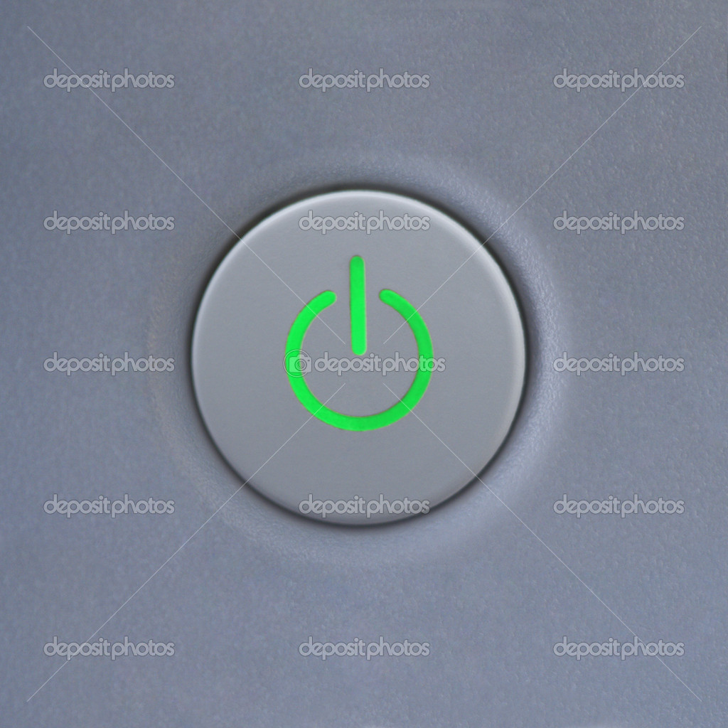 Close up of power symbol on power button on computer.  Stock Photo #9553683