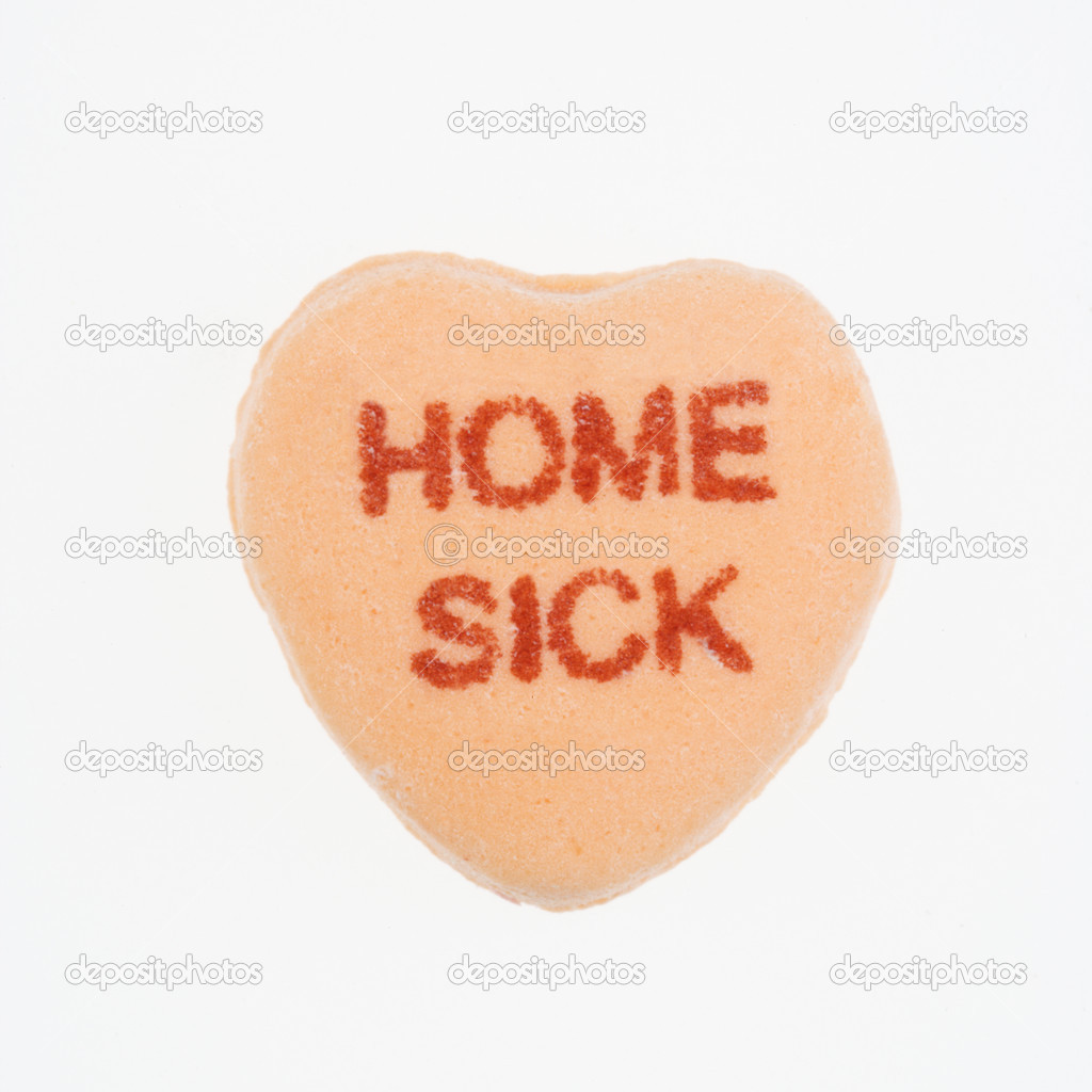 Orange candy heart that reads home sick against white background.  Stock Photo #9553854