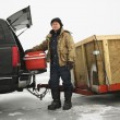 Man going ice fishing. - Stock Photo