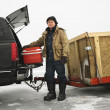 Man going ice fishing. — Stock Photo