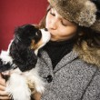 Woman kissing dog. — Stock Photo