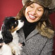 Woman holding dog. — Stock Photo