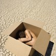 Nude woman in desert. - Stockfoto