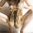 Nude woman with boots. — Stock Photo