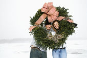 Young Couple with Wreath — Stock Photo