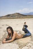 Topless muddy woman. — Stock Photo