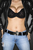 Woman in bra and jacket. — Stock Photo