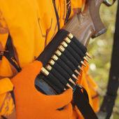 Hunter removing bullet from ammo holder. — Stock Photo