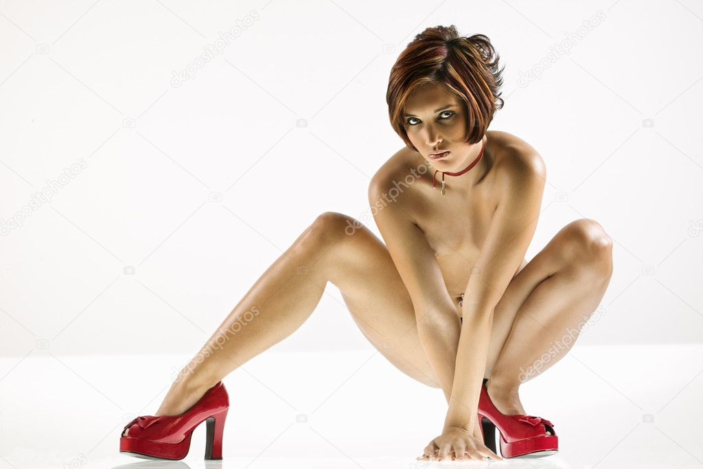 Studio portrait of young partially nude Caucasian woman. — Stock Photo #9613422