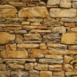Old dry masonry stonewall — Stock Photo