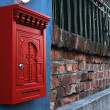 Post box on brick wall — Stock Photo