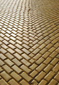 Yellow ceramic pavement — Stock Photo