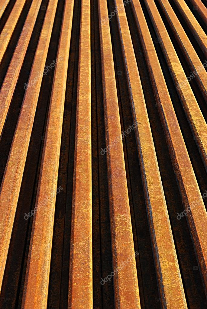 Rusty rails lined-up close as background perspective — Stock Photo #9922058